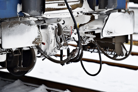 buffers: Detail shot with frozen train wagon buffers and connection links in winter