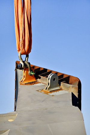 hooked up: Heavy duty chain hooked up on a construction crane lifting concrete a structure