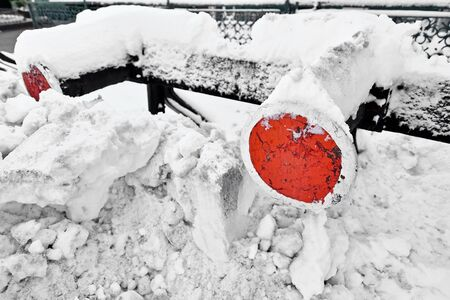 buffers: Railway buffers at the end of the rail in a train station after heavy snowfall
