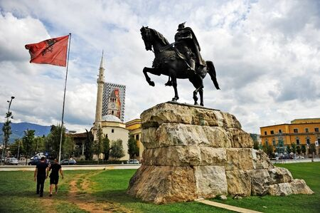 national hero: TIRANA, ALBANIA - SEPTEMBER 24: Statue of albanian national hero Skanderbeg, alsi known as George Castriot, is seen during daytime in Skanderbeg square on September 24, 2015 in Tirana.