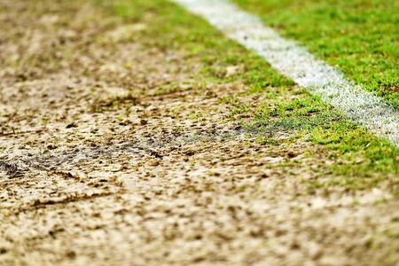 Detail shot with damaged turf on the sideline of a soccer field