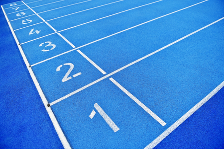 sports track: Blue track and field sprint finish line positions with no people