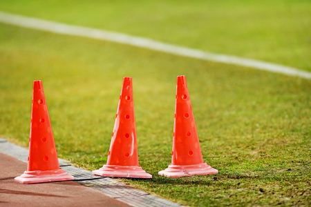 sideline: Soccer marker cones for training are seen on the sideline of a soccer field