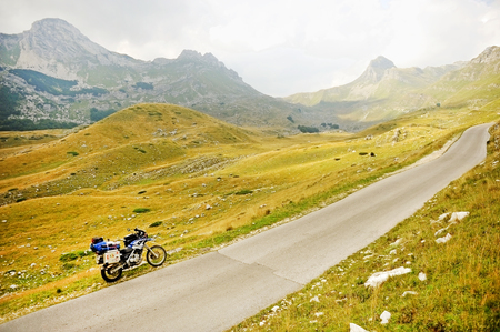 mountain pass: MONTENEGRO, ZABLJAK - AUGUST 26: Adventure motorcycle loaded with luggage in Sedlo mountain pass, part of Durmitor National Park, on August 26, 2015 in Montenegro.
