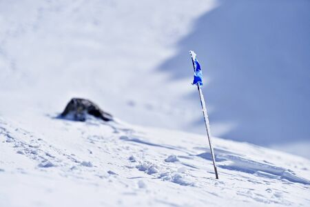 wind blown: Blue flag blown by the wind on a mountain in winter
