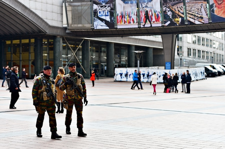european parliament: BRUSSELS, BELGIUM - MARCH 16: Belgian soldiers on patrol in European Parliament zone due to a raised level of a possible terror attack, on March 16, 2016 in Brussels.