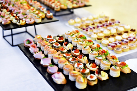 Catering food shot with small appetizers on plates ready for eat Imagens