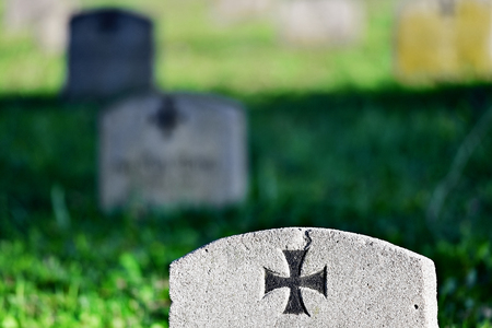 graveyard: Gravestone of a german soldier with the iron cross symbol in a heroes graveyard