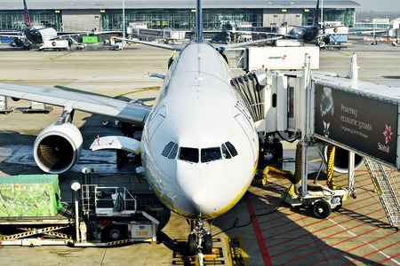 march 17: BRUSSELS, BELGIUM - MARCH 17: Airplanes on the boarding gates of Zaventem International Airport, on March 17, 2016 in Brussels.