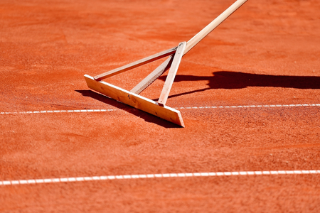 tennis clay: Maintenance of a tennis clay court with a rake