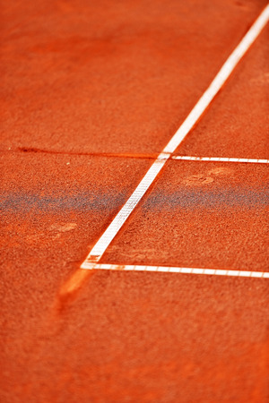 tennis clay: Detail with a baseline footprint on a tennis clay court Stock Photo