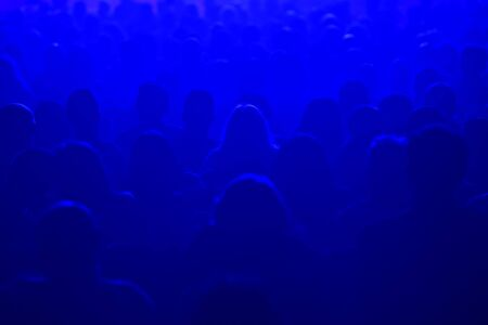 laser lights: Unrecognizable people watching a beautiful laser show with multicolored lights Stock Photo