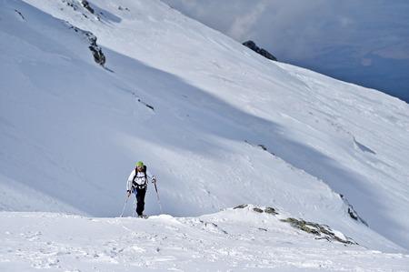 fagaras: FAGARAS, ROMANIA - MARCH 5: Ski mountaineer competes during the Ski Mountaineering National Competition in Fagaras Mountains, Carpathian Range, on March 5, 2016 in Romania.