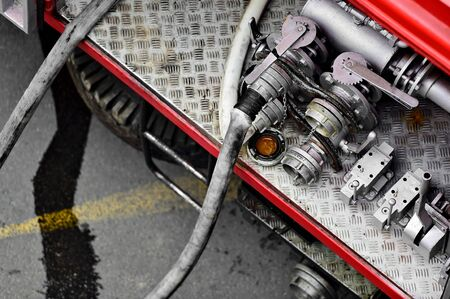 hoses: Detail with heavy duty water hoses on a firefighter vehicle