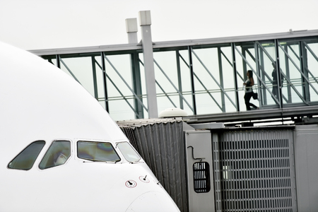 unrecognizable people: Unrecognizable people boarding into big airplane Stock Photo