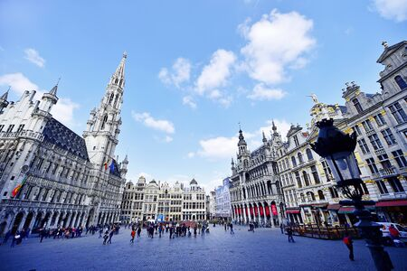 BRUSSELS, BELGIUM - MARCH 16: Wide angle shot with tourists visiting the Grand Place on March 16, 2016 in Brussels.