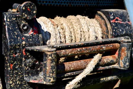 winch: Detail shot with heavy duty rope winch on a off road truck