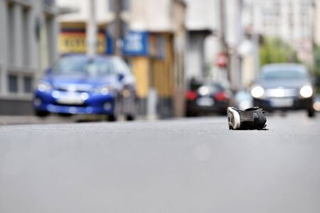 fatality: Shoe on the street with cars in background after victim was hit by vehicle