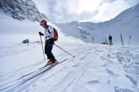 FAGARAS, ROMANIA - MARCH 5: Ski mountaineer competes during the Ski Mountaineering National Competition in Fagaras Mountains, Carpathian Range, on March 5, 2016 in Romania.