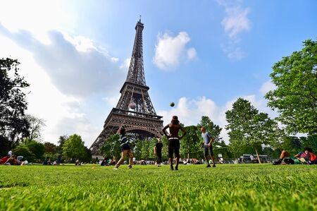 PARIS, FRANCE - JUNE 8: Giant soccer ball suspended on the Eiffel Tower during the UEFA 2016 European Championship on June 8, 2016 in Paris. Editorial