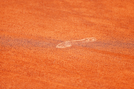 tennis shoe: Detail with a sport shoe footprint on a tennis clay court