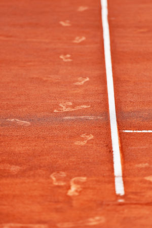 tennis shoe: Detail with sport shoe footprints on a tennis clay court