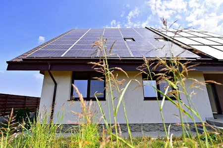 electric grid: Renewable energy house with solar and thermal photovoltaic panels on roof