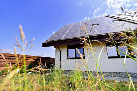 Renewable energy house with solar and thermal photovoltaic panels on roof