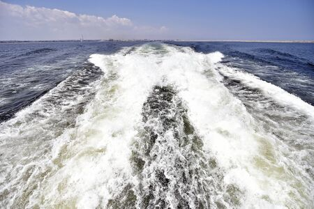 big waves: Big waves done by motorboat into the sea