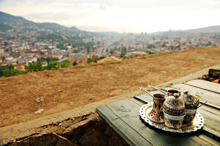 bosna and herzegovina: Two cups of bosnian traditional coffee on a wooden table