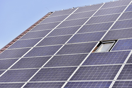 electric grid: House roof with renewable energy solar and thermal photovoltaic panels