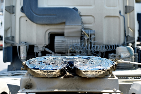 greased: Detail with a greased fifth wheel truck coupling mechanism Stock Photo