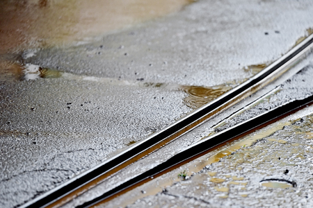 rainfall: Detail shot with tramway track during rainfall