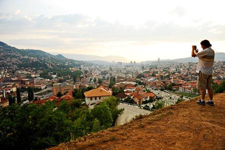 sarajevo: BOSNIA AND HERZEGOVINA, SARAJEVO - AUGUST 27: Sarajevo city panoramic shot from a hill at sunset on August 27, 2016 in Sarajevo.