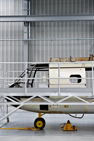 fuselage: Detail with helicopter fuselage on the repair line in a factory
