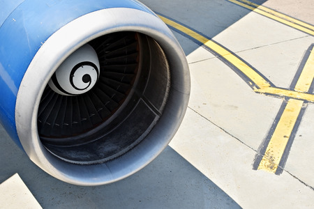 turbofan: Big airplane propeller engine detail on the runway