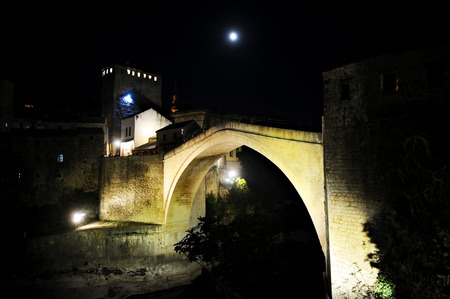 hercegovina: Tourists on the the old bridge of Mostar, known as Stari Most, at night Stock Photo