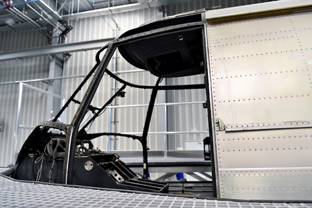 disassemble: Detail with helicopter fuselage on the repair line in a factory