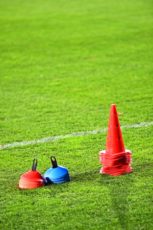 Soccer training cones on artificial green turf