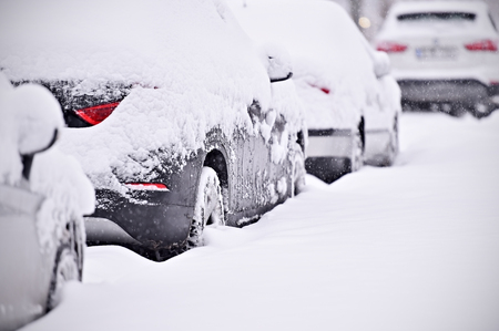 frost winter: Snow covered cars are seen during snowfall in the city