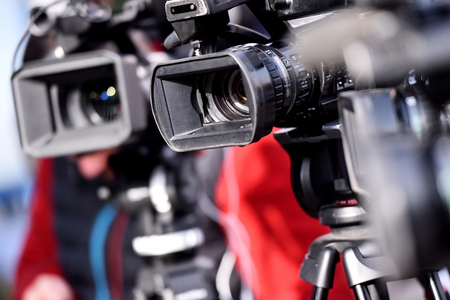 Lots of television cameras in a row broadcasting a live media event Stock Photo
