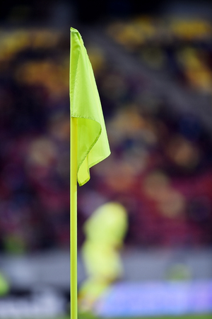 Detail with soccer yellow corner flag on a stadium Stock Photo