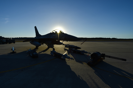 Fighter aircraft with ammunition and missiles on the runway Stock Photo