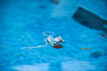 Underwater photo camera housing floating in a swimming pool