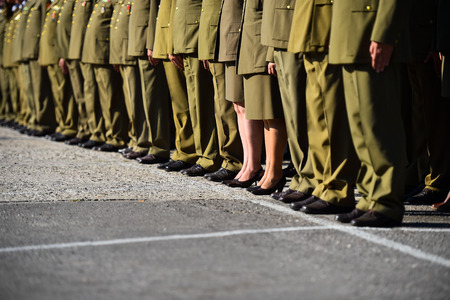 Detail with women in uniforms standing in formation during military ceremony Stock Photo