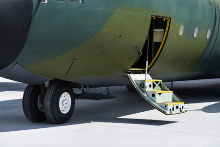 Detail of a military Hercules airplane on the runway