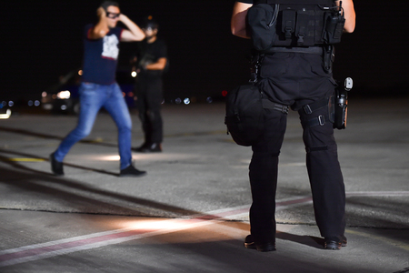 Night scene with special forces showing their skills in a simulated hostage rescue drill Banco de Imagens