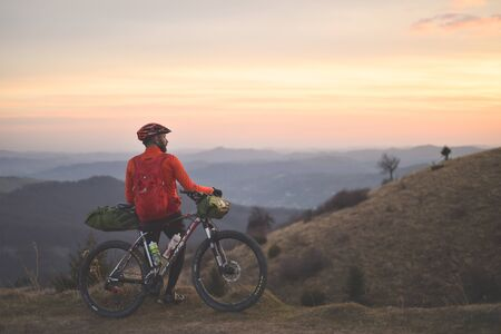 PRAHOVA/ROMANIA - OCTOBER 28, 2018: Autumn mountain scene riding with a mountain bike equipped with travel bags.