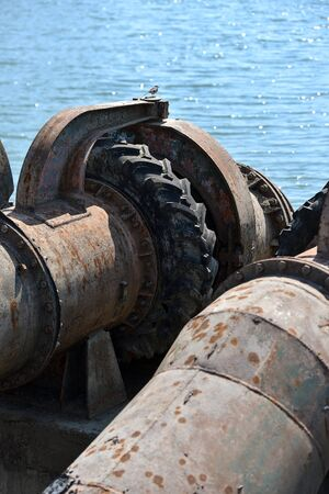 Industrial pipes used to pump water from a river to irrigate drought fields
