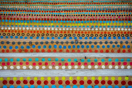 Colorful circles painted on the wooden stairs